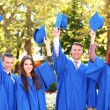 Students throwing graduation hats — Stock Photo #56865719