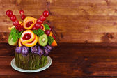 Table decoration made of fruits on wooden table on wooden wall background — Stock Photo