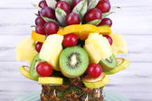 Table decoration made of fruits on grey wooden background — Stock Photo