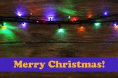 木製の背景にクリスマス ライト — ストック写真