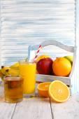 Glass of orange juice and fresh fruits — Stock Photo