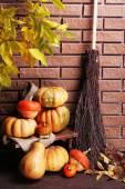 Pumpkins on stool — Stock Photo