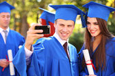 Students with diplomas — Stock Photo