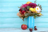 Flower bouquet in blue vase — Stock Photo