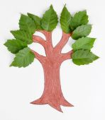Leaves with painted tree — Stock Photo