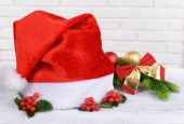 Leaves of mistletoe with Christmas hat — Stock Photo