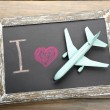 I love travelling by airplane written on chalkboard — Stock Photo #56880745