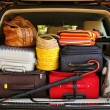 Suitcases and bags in trunk of car — Stock Photo #56881213