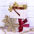 Постер, плакат: Holiday gift boxes decorated with vinous ribbon