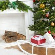 Christmas tree near fireplace — Stock Photo #56882007