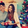 Couple  near Christmas tree — 图库照片 #56883199