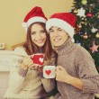 Couple  near Christmas tree — 图库照片 #56883295
