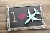 I love travelling by airplane written on chalkboard — Stock Photo