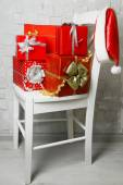 Christmas presents on white chair — Stock Photo
