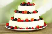 Beautiful wedding cake with berries — Stock Photo
