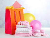 Baby clothes and gift bag — Stok fotoğraf