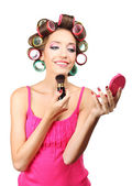 Beautiful girl in hair curlers isolated on white — Stock Photo
