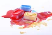 Watercolor paint cubes and spilled paint — Stock Photo