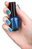 Nail polish in hand — Stock Photo