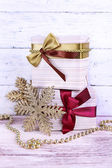Holiday gift boxes decorated with vinous ribbon — Stock Photo