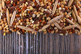 Groats mixture on wooden background — Stock Photo