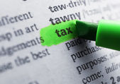 Green marker highlighting word in dictionary — Stock Photo