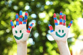 Smiling colorful hands — Stock Photo