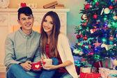 Couple  near Christmas tree — Stock Photo