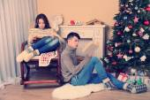 Couple  near Christmas tree — Stock Photo