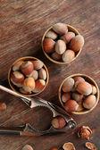 Hazelnuts in wooden bowls — Stock Photo