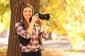 Young photography take photos in park — Zdjęcie stockowe