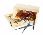 Keys and lock picks in wooden box — Stock Photo