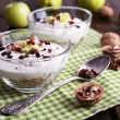 Oatmeal with yogurt in bowls, apples and walnuts — Stock Photo #57034115