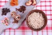 Bowl of oatmeal, mug of yogurt, marmalade — Foto de Stock