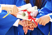 Graduate students with diplomas, close-up — Foto Stock