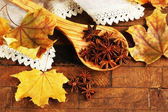 Stars anise in wooden spoon — Stock Photo