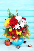 Flower bouquet in blue vase — Stock Photo