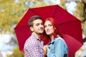 Loving couple under umbrella — Stock Photo
