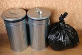 Recycling bins on wall background — Stock Photo