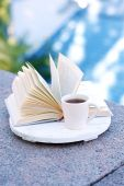 Cup with hot drink and book — Stock Photo