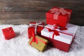 Gift boxes on wooden background — Stock Photo