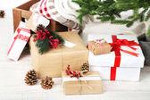 Christmas presents  near Christmas tree — Stockfoto