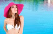 Beautiful young woman in swimsuit at pool — Stock Photo
