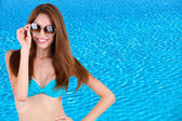 Beautiful young woman in swimsuit at pool — Foto Stock
