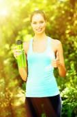 Young woman after long run at park — Stock Photo