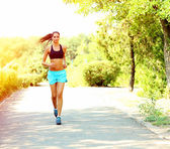 Young woman jogging at park — Stock Photo