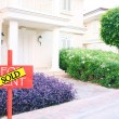 Sold home for sale real estate sign and beautiful new house — Stock Photo #57303319