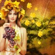 Beautiful young woman with yellow autumn wreath outdoors — Stock Photo #57304337