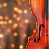 Classical violin on bright background — Stock Photo