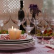 Buffet table with dishware and candles waiting for guests — Stock Photo #57433415